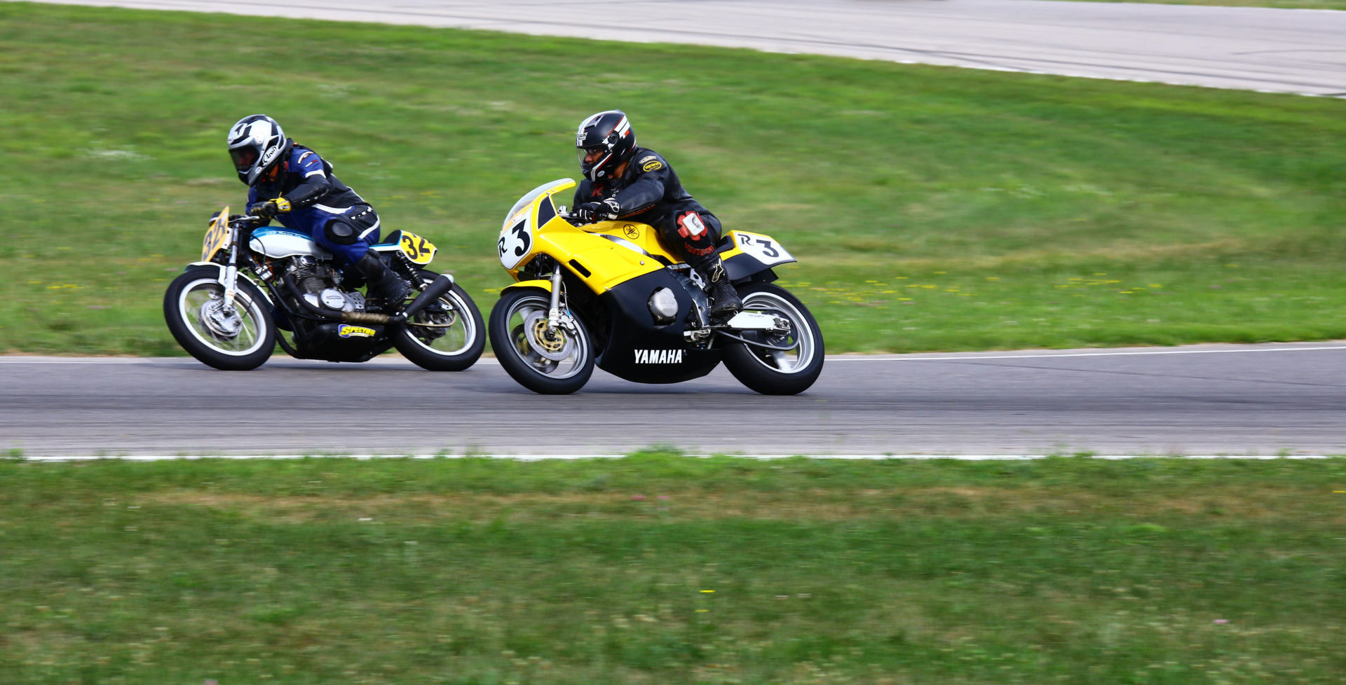 AHRMA racers David Felpel (32X) and Rick Richter (R3) in action at Gingerman Raceway. Photo by Jack Lahrman, courtesy AHRMA.