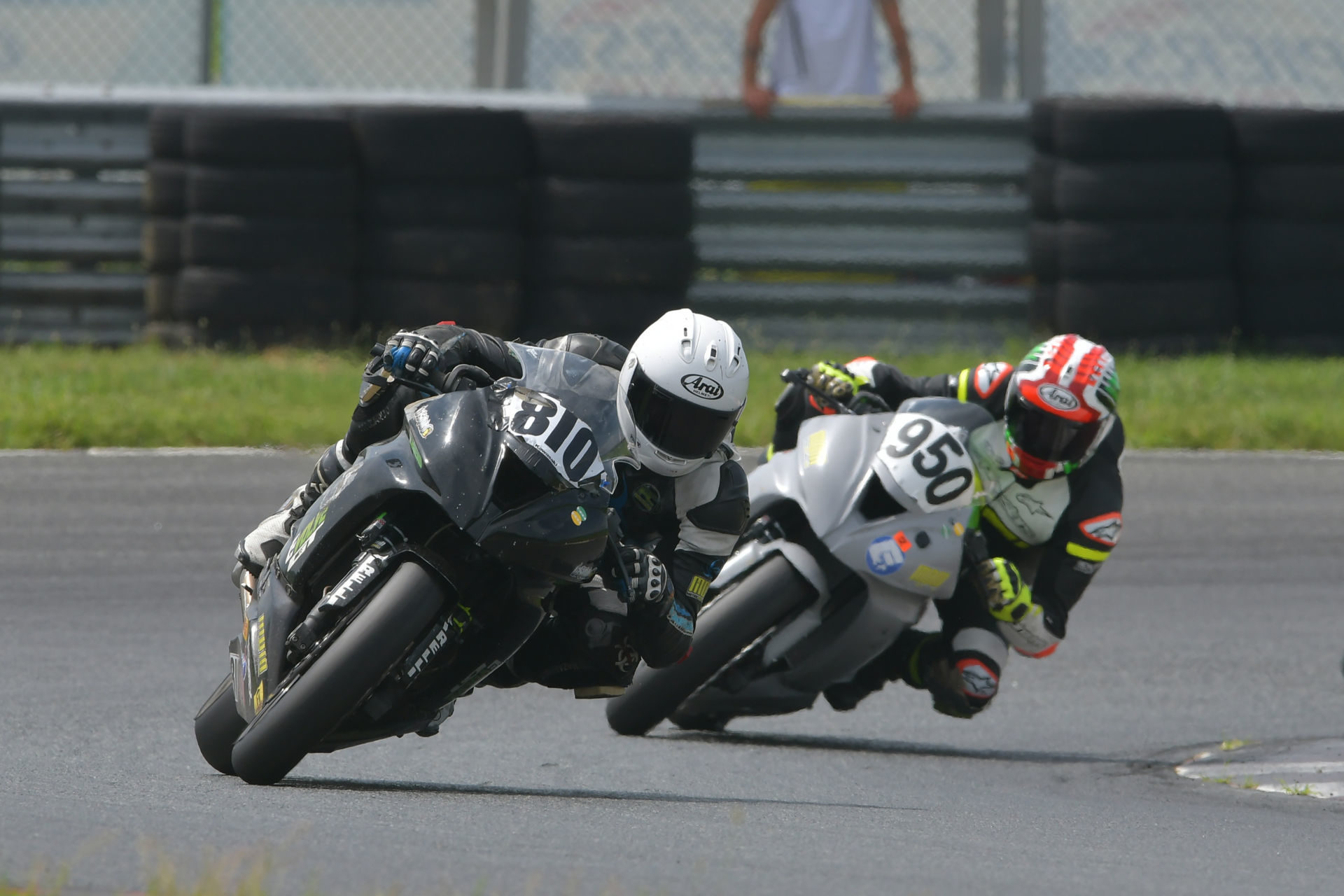 Jeremy Brinker (810) and Jeff Schoff (950) fight for the lead in the Motogladiator Superbike 1000cc race at NJMP. Photo by The SB Image, courtesy of Motogladiator.