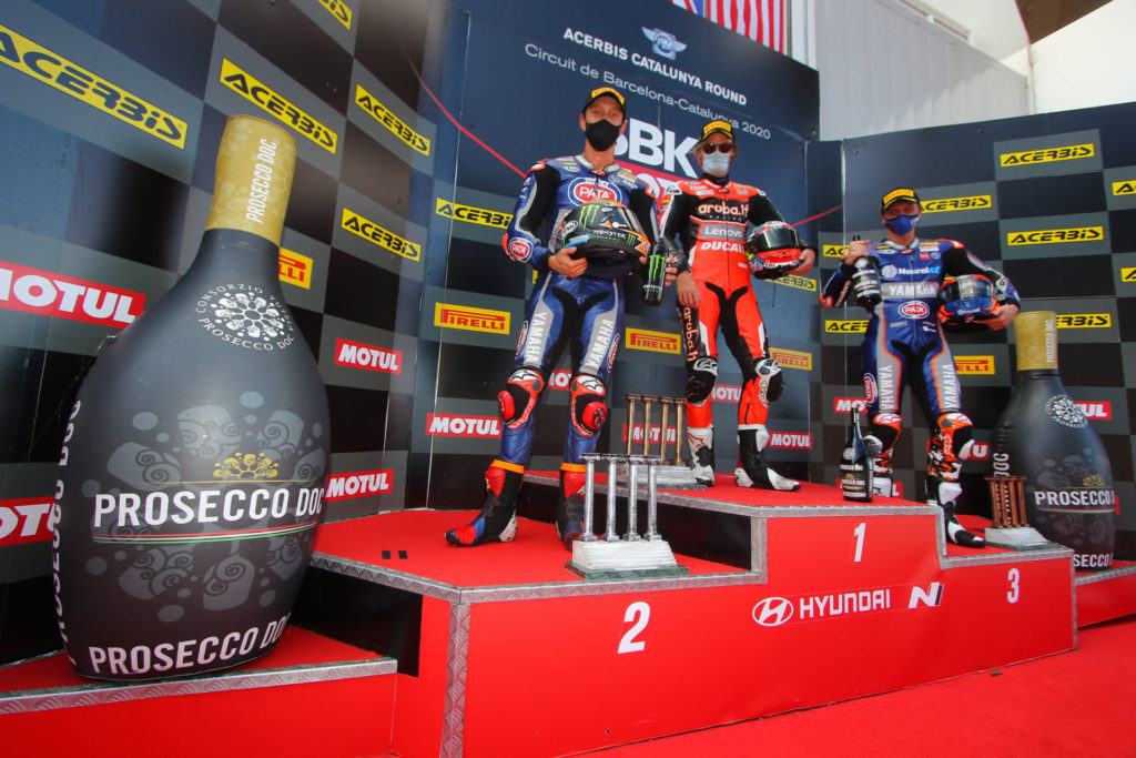 Race Two winner Chaz Davies (center)  flanked by second place Michael van der Mark (left)  and third place Garrett Gerloff (right). Photo courtesy Dorna.