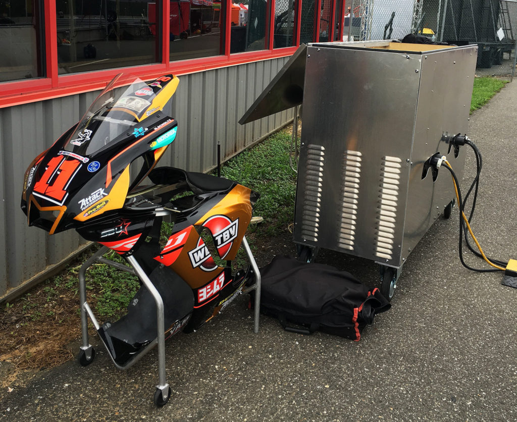 Seen On Pit Lane: Westby Racing's generators are encased in a ventilated stainless steel cart, and a set of spare bodywork has its own lightweight, wheeled cart. Photo by John Ulrich.