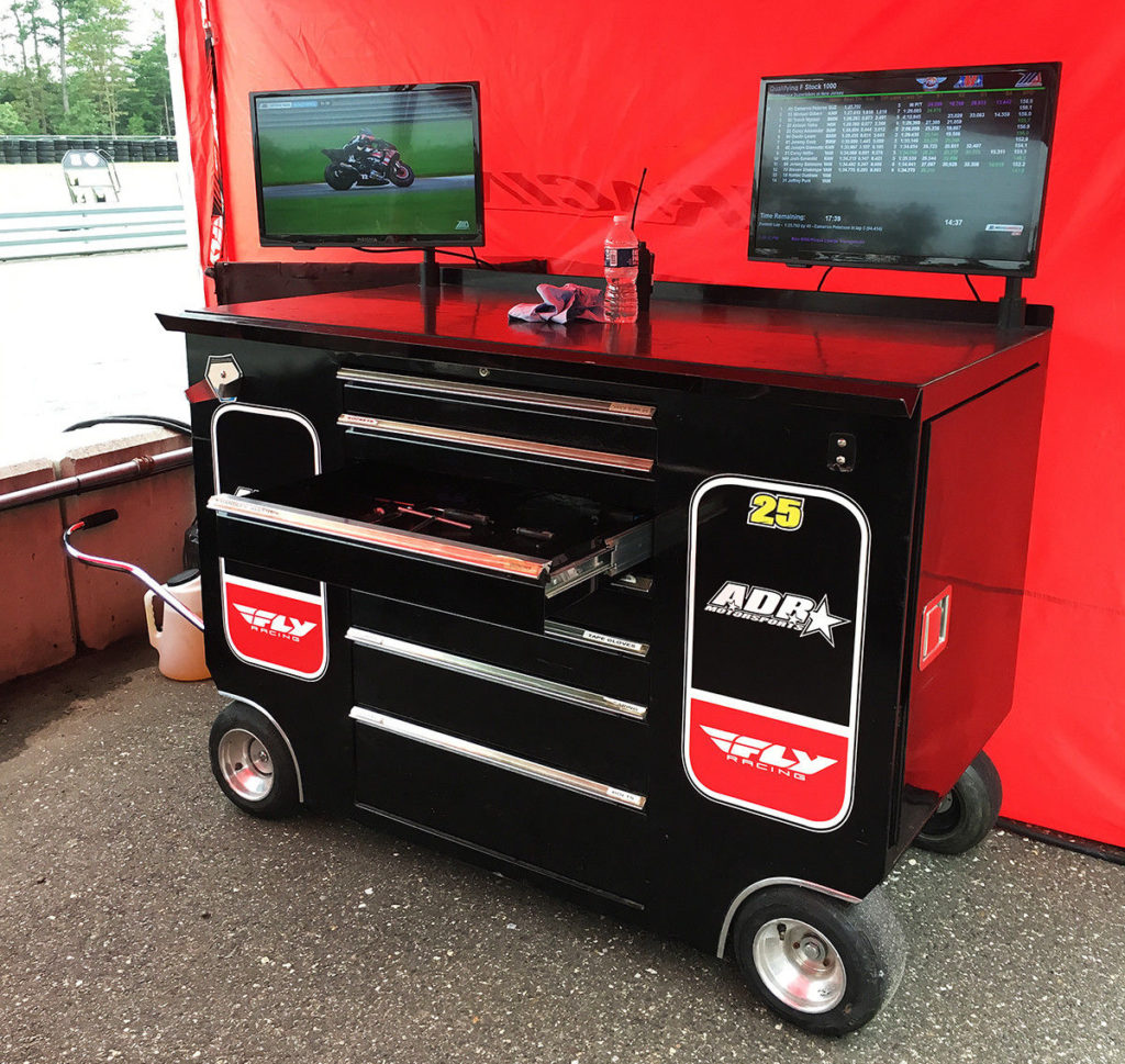 Seen On Pit Lane: Aussie Dave Racing (ADR) has a rolling toolbox with a TV for the live video feed and another TV for the timing and scoring feed. Photo by John Ulrich.