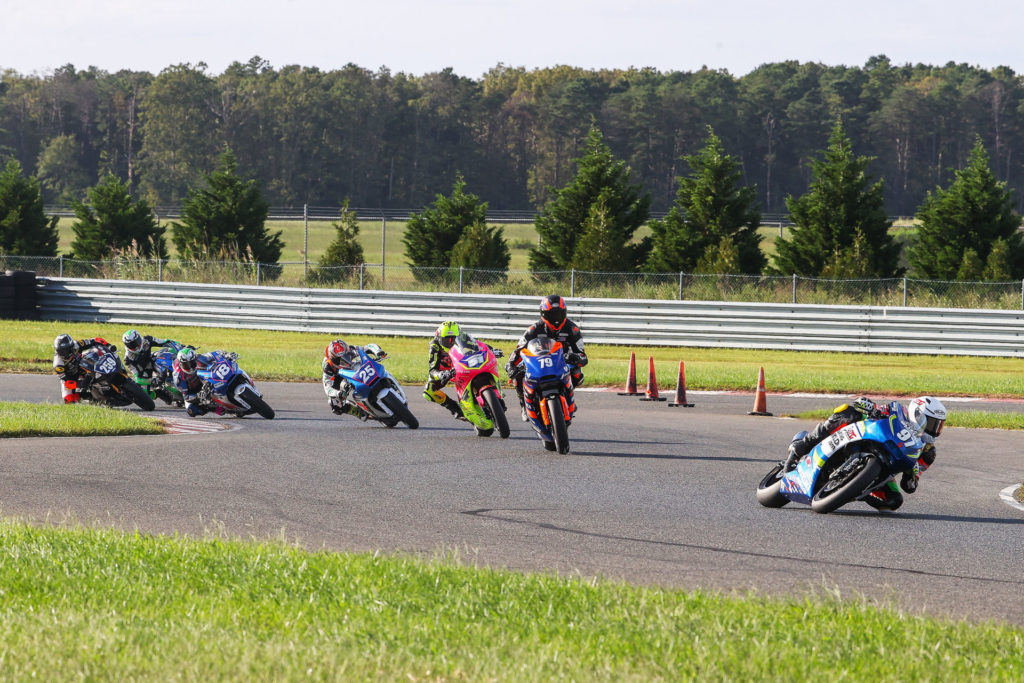 Rocco Landers (97) is doing double duty at MotoAmerica events, winning in both Junior Cup (on a Kawasaki Ninja 400) and in Twins Cup races (on a Suzuki SV650). Here, Landers leads the first Twins Cup race on a SportbikeTrackGear.com SV650, chased by Teagg Hobbs (79), on another Suzuki SV650; Kaleb De Keyrel (51) on a Yamaha MT-07; Dominic Doyle (25), Jackson Blackmon (18), and Toby Khamsouk (27) on SV650s; and Hayden Schultz on a Yamaha MT-07. Photo by Brian J. Nelson.
