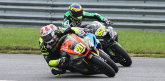 New Jersey's own Brandon Paasch (21) stuffs it under Sean Dylan Kelly (40) who was already under Richie Escalante (54) in Supersport Race Two, one of the best Supersport battles seen in decades. Photo by Brian J. Nelson.