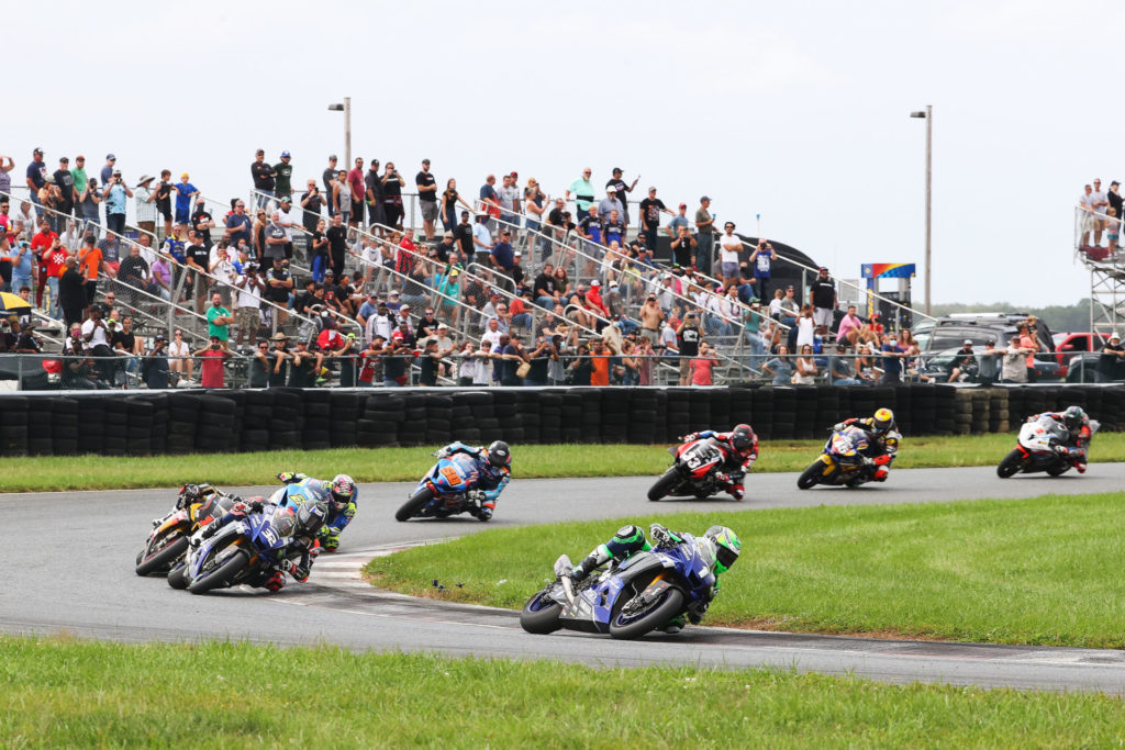 The unstoppable Cameron Beaubier (1) jumps out front of Sunday's MotoAmerica Superbike race at New JErsey Motorsports Park, chased by Jake Gagne (32), Mathew Scholtz (11), Bobby Fong (50), Kyle Wyman (33), Cam Petersen (45), and Josh Herrin (2). Photo by Brian J. Nelson.