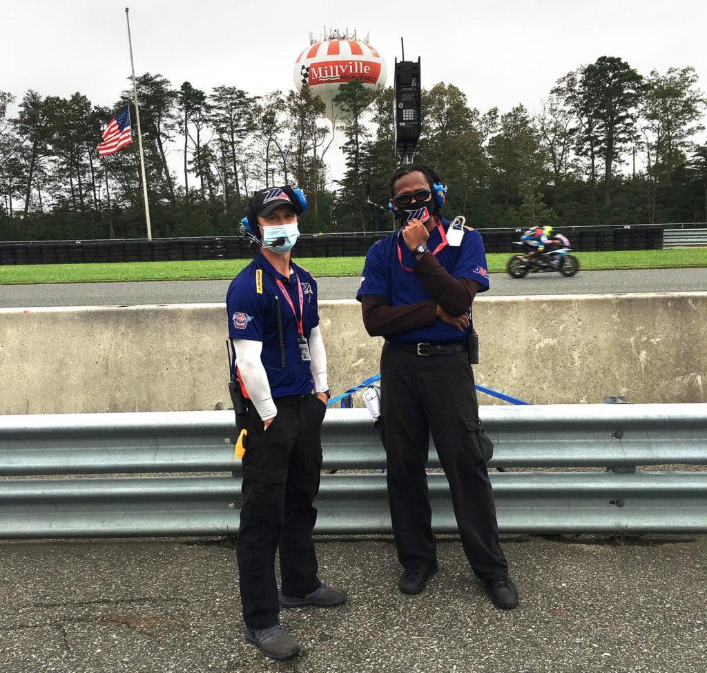 MotoAmerica officials Matt Kellerman (left) and Jonathan Matthews (right) working on pit lane. Photo by John Ulrich.