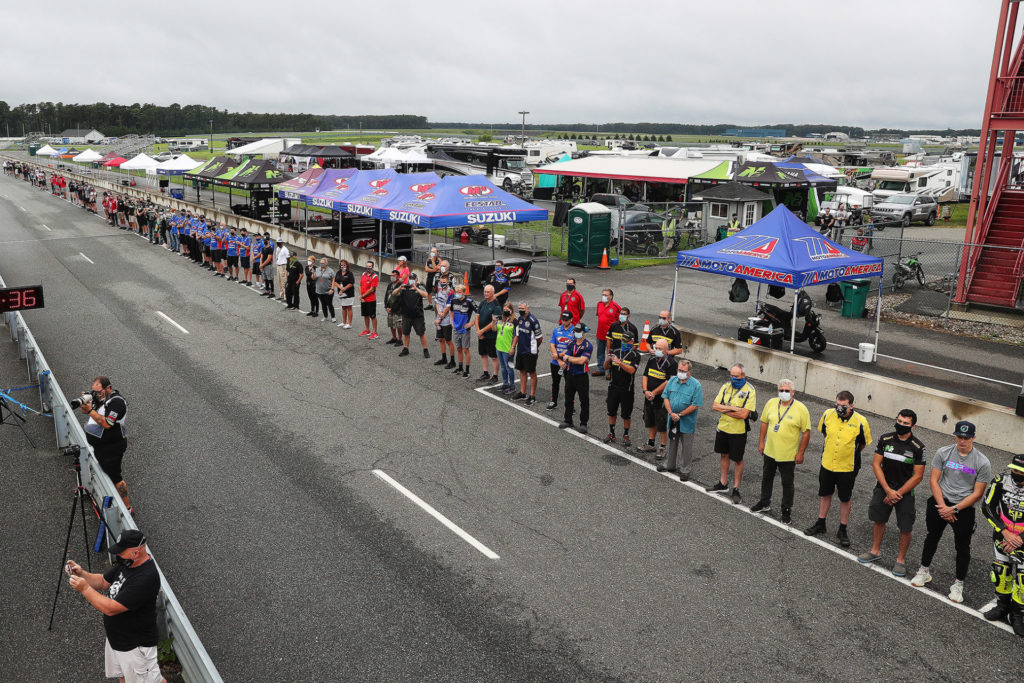 Race team members lining up on the front straightaway at New Jersey Motorsports Park on Friday morning of the race weekend, September 11th, remembering the Americans killed on the 19th anniversary of the terrorist attacks known as 9/11. Photo by Brian J. Nelson.