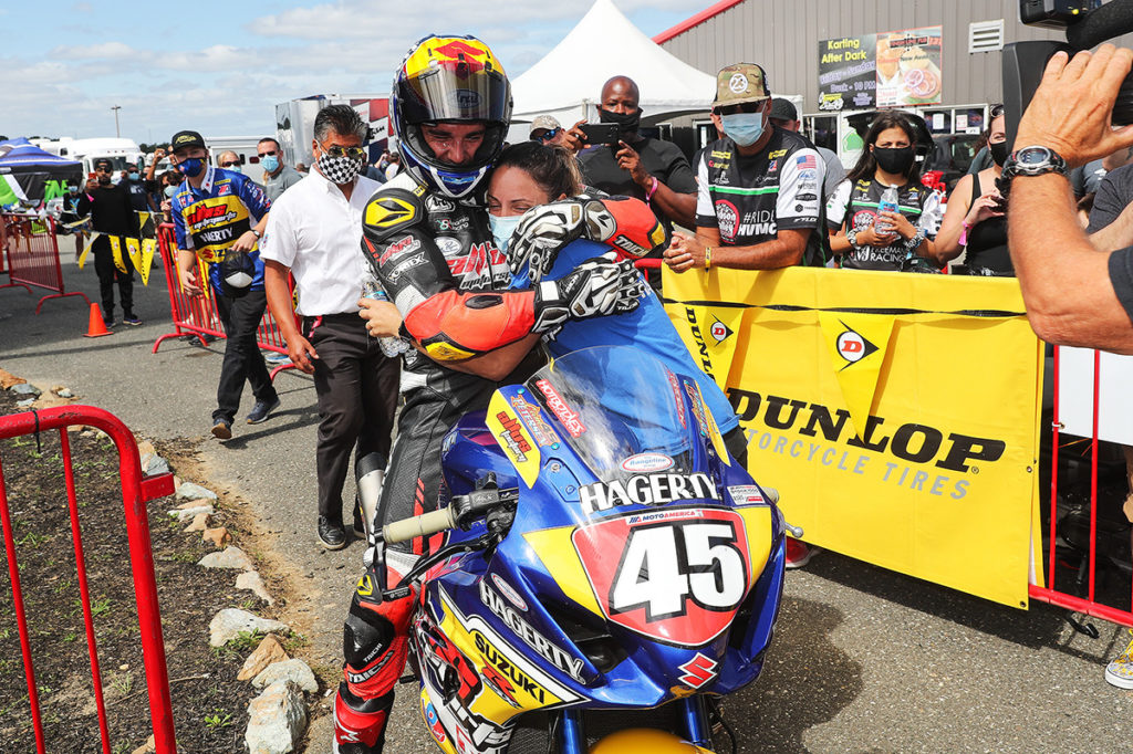Crew Chief Melissa Paris and rider Cam Petersen hug after he won the Stock 1000 race at NJMP. Photo by Brian J. Nelson.