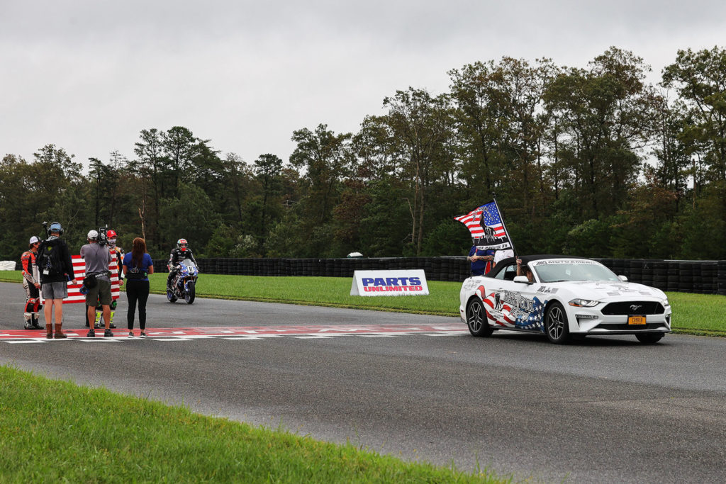 BARTCON Racing paraded a patriotic Mustang on a lap as part of the 9/11 memorial held on Friday. Photo by Brian J. Nelson.