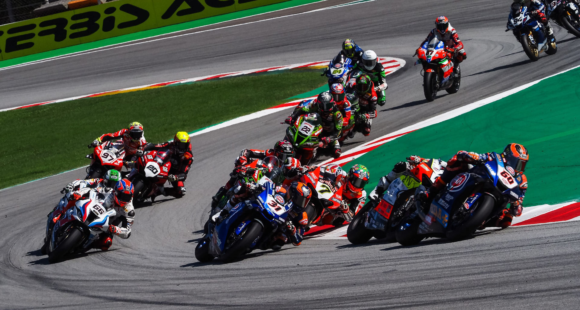 The start of World Superbike Race Two at Catalunya with Michael van der Mark (60) leading Michael Rinaldi, Garrett Gerloff (31), Chaz Davies (7), Jonathan Rea, Scott Redding, and the rest of the field. Photo courtesy Dorna.