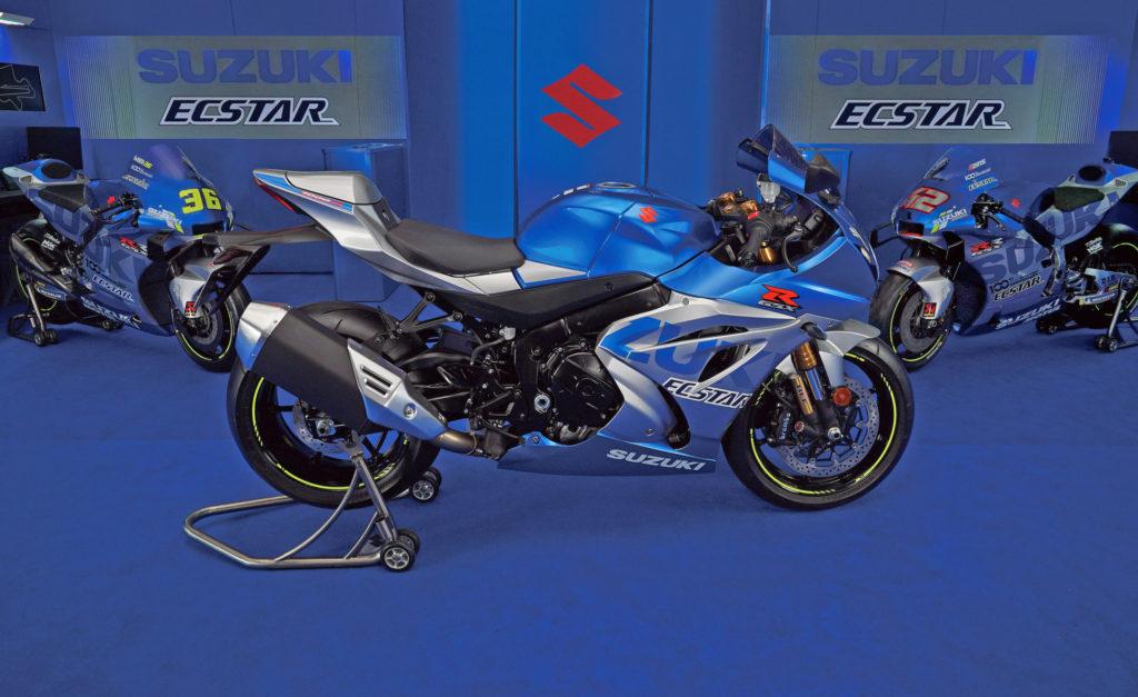 A limited-edition 100th Anniversary Suzuki GSX-R1000R (left) with Suzuki GSX-RR MotoGP racebikes. Photo courtesy Suzuki.