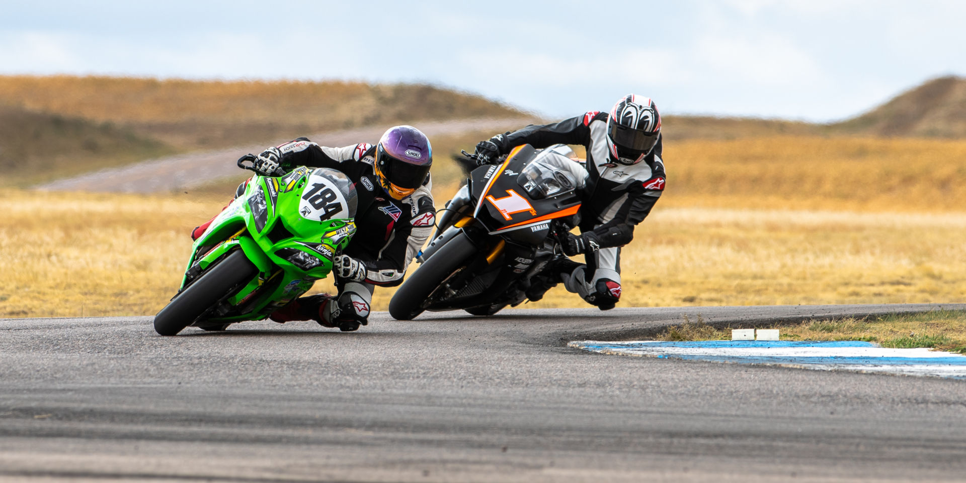 Andrew Lee (184) leading Ryan Burke (1) in the Race of the Rockies at High Plains Raceway. Photo by Luke Hummel Photography, courtesy MRA.