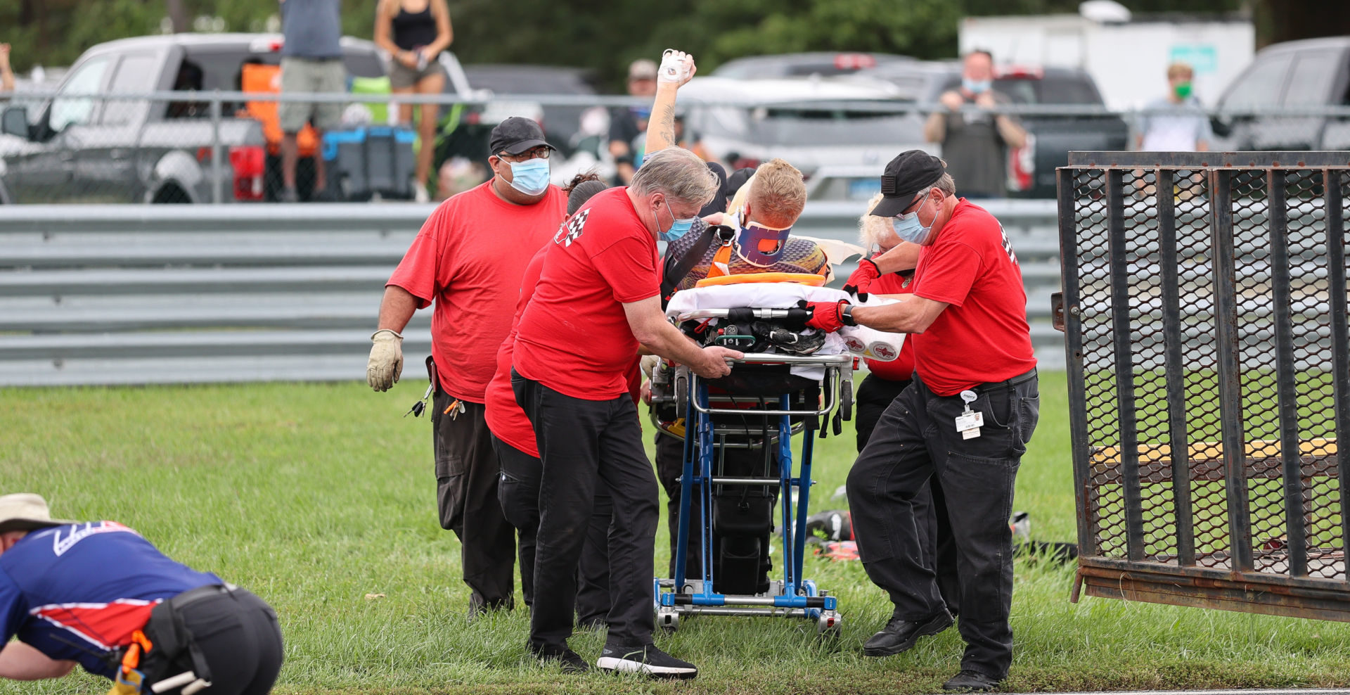 Bradley Ward raises his fist to acknowledge cheering fans as medical workers attend to him after his crash in MotoAmerica Superbike Race Two at New Jersey Motorsports Park. Photo by Brian J. Nelson, courtesy Bradley Ward Racing.