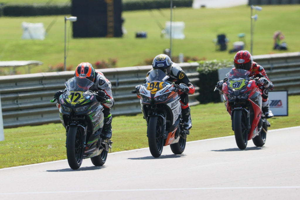 Ben Gloddy (72) leading Liam Grant (94) and Sam Lochoff (57) at Barber Motorsports Park. Photo by Brian J. Nelson, courtesy Quarterley Racing On Track Development.