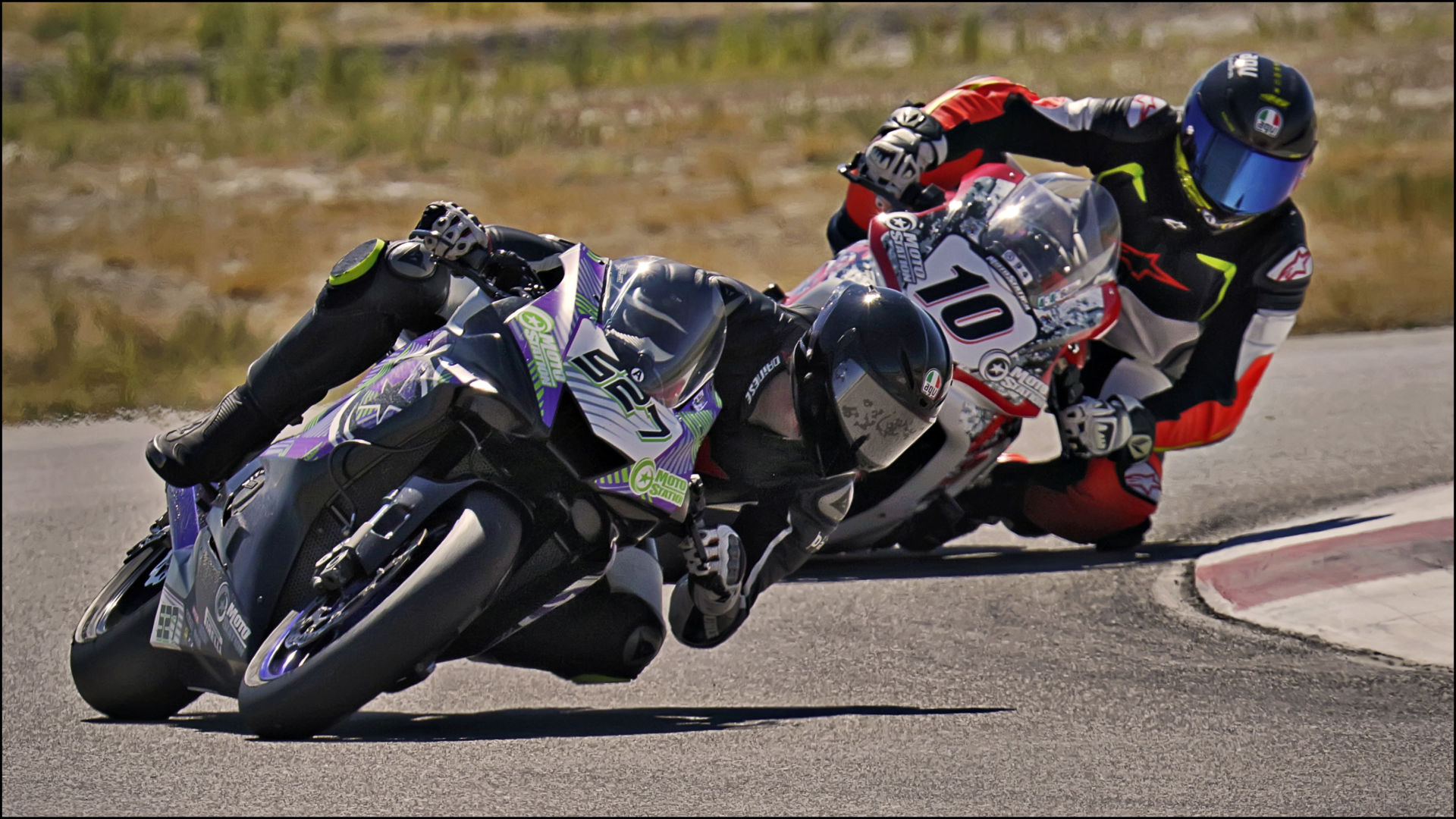 Jerry Hicks (527) holds off Eric Jones (10) during the UtahSBA King of the Mountain GTO finale at Utah Motorsports Campus. Photo by Steve Midgley, courtesy UtahSBA.