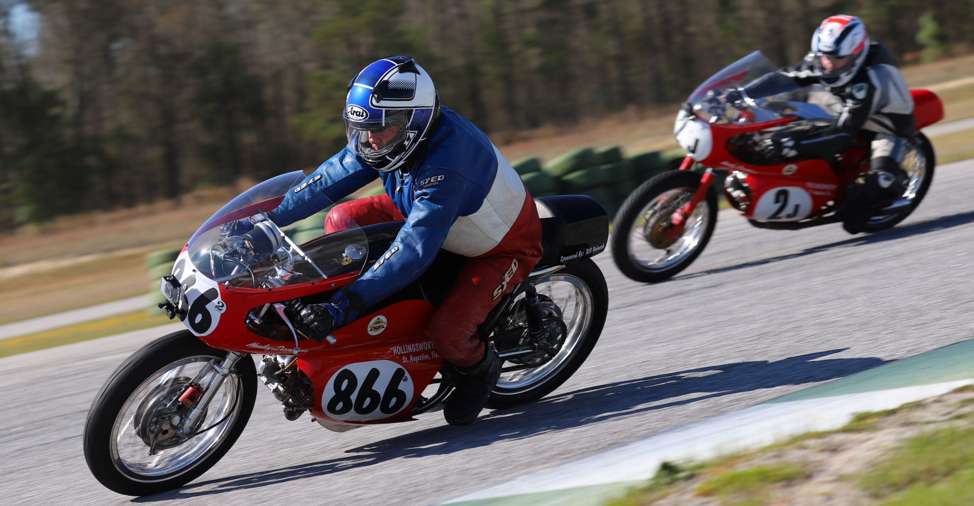 AHRMA racers Jonathan Hollingsworth (2J) and Dick Hollingsworth (866) in action. Photo by etechphoto.com, courtesy AHRMA.