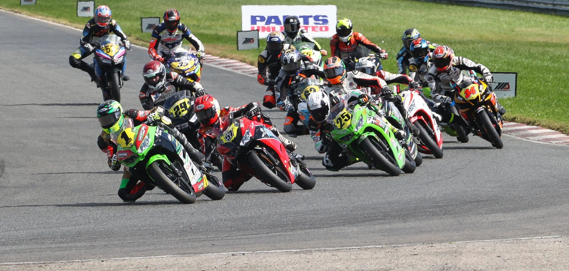 Rocco Landers (1) leads the field into Turn One at the start of Junior Cup Race One. Photo by Brian J. Nelson, courtesy MotoAmerica.