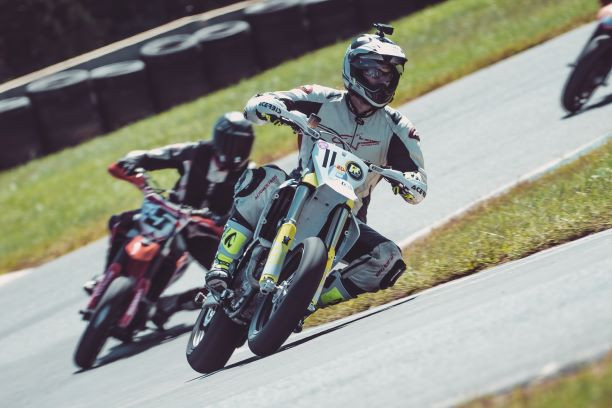 Matt Yarnell (11) and Matt Lamb (5) race for the lead in the Supermoto race. Photo by Vae Vang/Noiseless Productions, courtesy Motogladiator.