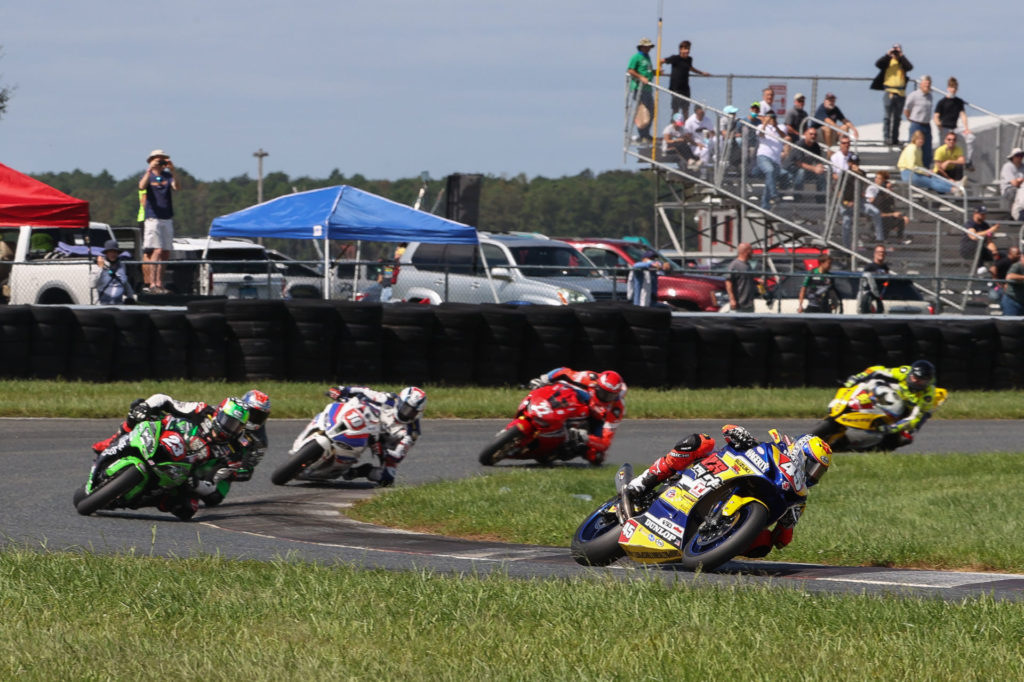 Cameron Petersen (45) leads Corey Alexander (23), Michael Gilbert, Travis Wyman (10), Ashton Yates, and Danilo Lewis (94) at the start of the Stock 1000 race. Photo by Brian J. Nelson, courtesy MotoAmerica.