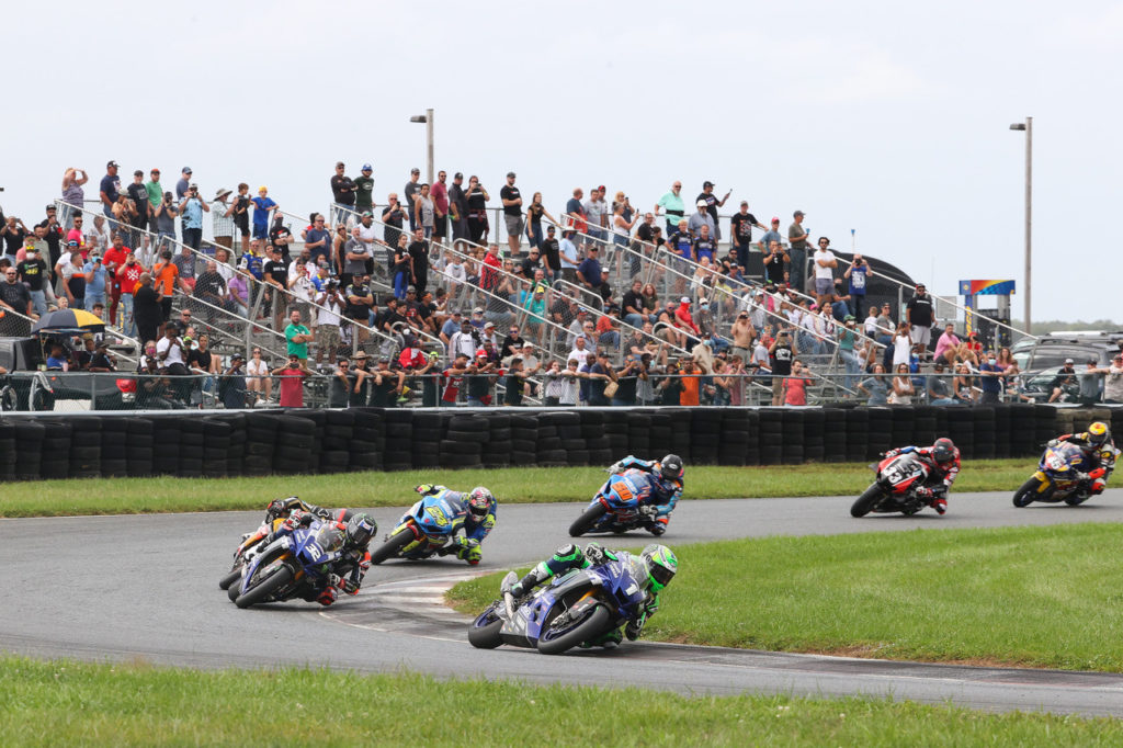 Cameron Beaubier (1) leads Jake Gagne (32), Mathew Scholtz (11), Toni Elias (24), Bobby Fong (50), Kyle Wyman (33), and Cameron Petersen early in MotoAmerica Superbike Race Two in New Jersey. Photo by Brian J. Nelson, courtesy MotoAmerica.
