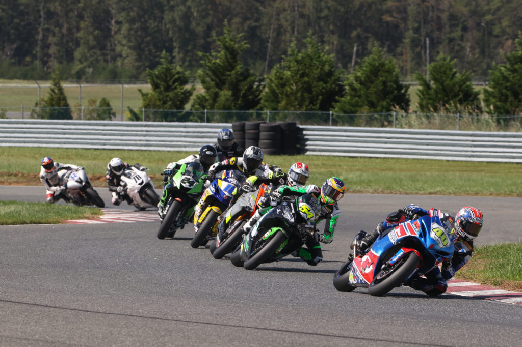 Sean Dylan Kelly (40) leads Richie Escalante (54), Brandon Paasch (21), Kevin Olmedo (16), Xavier Zayat (24) and the rest of the field at the start of Supersport Race One. Photo by Brian J. Nelson, courtesy MotoAmerica.