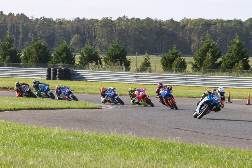 Rocco Landers (97) leads Teagg Hobbs (79), Kaleb De Keyrel (51), Dominic Doyle (25), Jackson Blackmon (18), Toby Khamsouk (27), and Hayden Schultz (259) at the start of Twins Cup Race One. Photo by Brian J. Nelson, courtesy MotoAmerica.