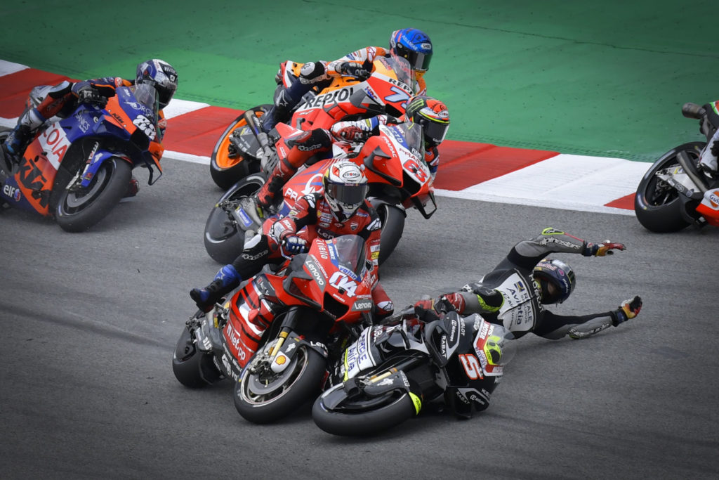 Andrea Dovizioso (04) was taken out by Johann Zarco (5) in a chain-reaction crash on the first lap. Photo courtesy Dorna.