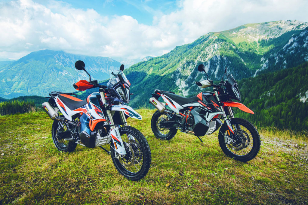 A 2021 KTM 890 Adventure R Rally edition (left) and a 2021 KTM 890 Adventure R (right) at rest. Photo by Sebas Romero, courtesy KTM.