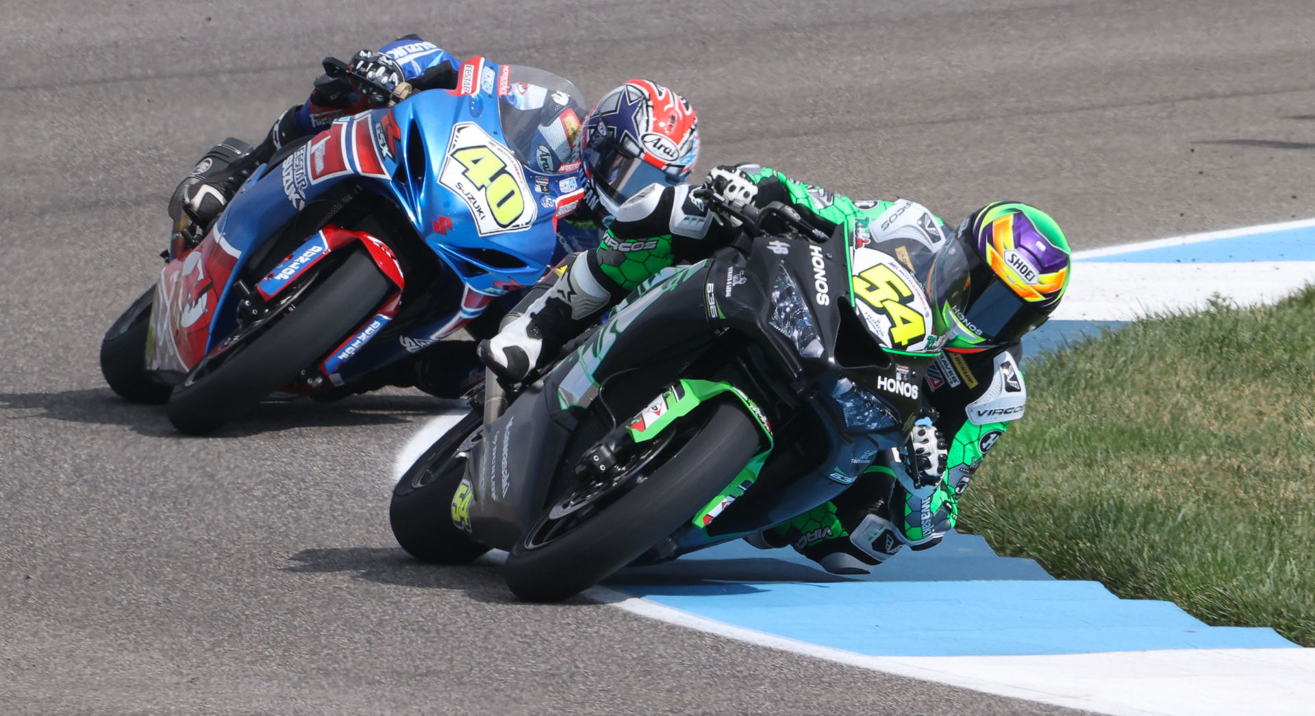 It's been like this all year in Supersport: Richie Escalante (54) vs. Sean Dylan Kelly (40). We can expect more or the same at WeatherTech Raceway Laguna Seca this coming weekend. Photo by Brian J. Nelson, courtesy MotoAmerica.