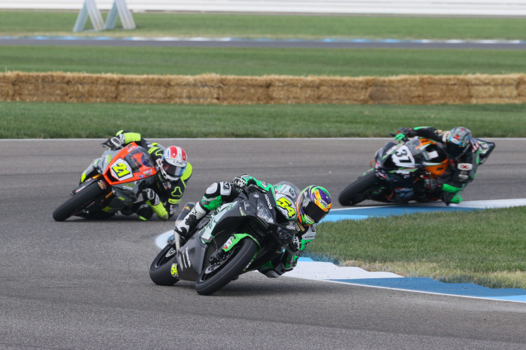 Brandon Paasch (21) and Stefano Mesa (37) chase leader Richie Escalante (54) early in Supersport Race One. Photo by Brian J. Nelson.