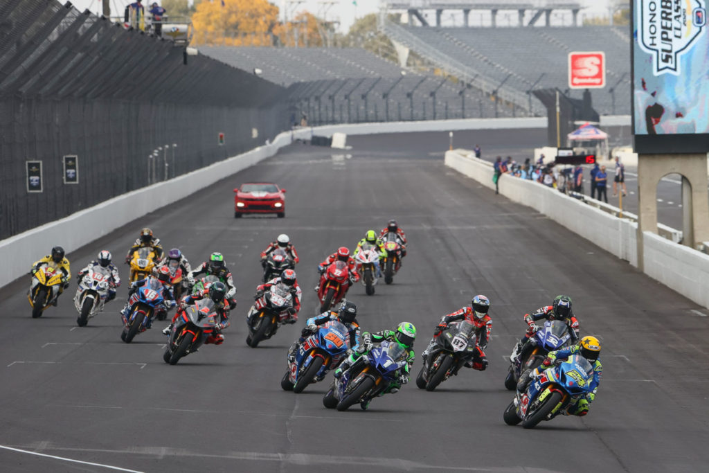 The second and final restart of MotoAmerica Superbike Race One with Toni Elias (24) leading Cameron Beaubier (1), Jake Gagne (32), Lorenzo Zanetti (87), Bobby Fong (50), Josh Herrin (2) and the rest of the field into Turn One. Photo by Brian J. Nelson.