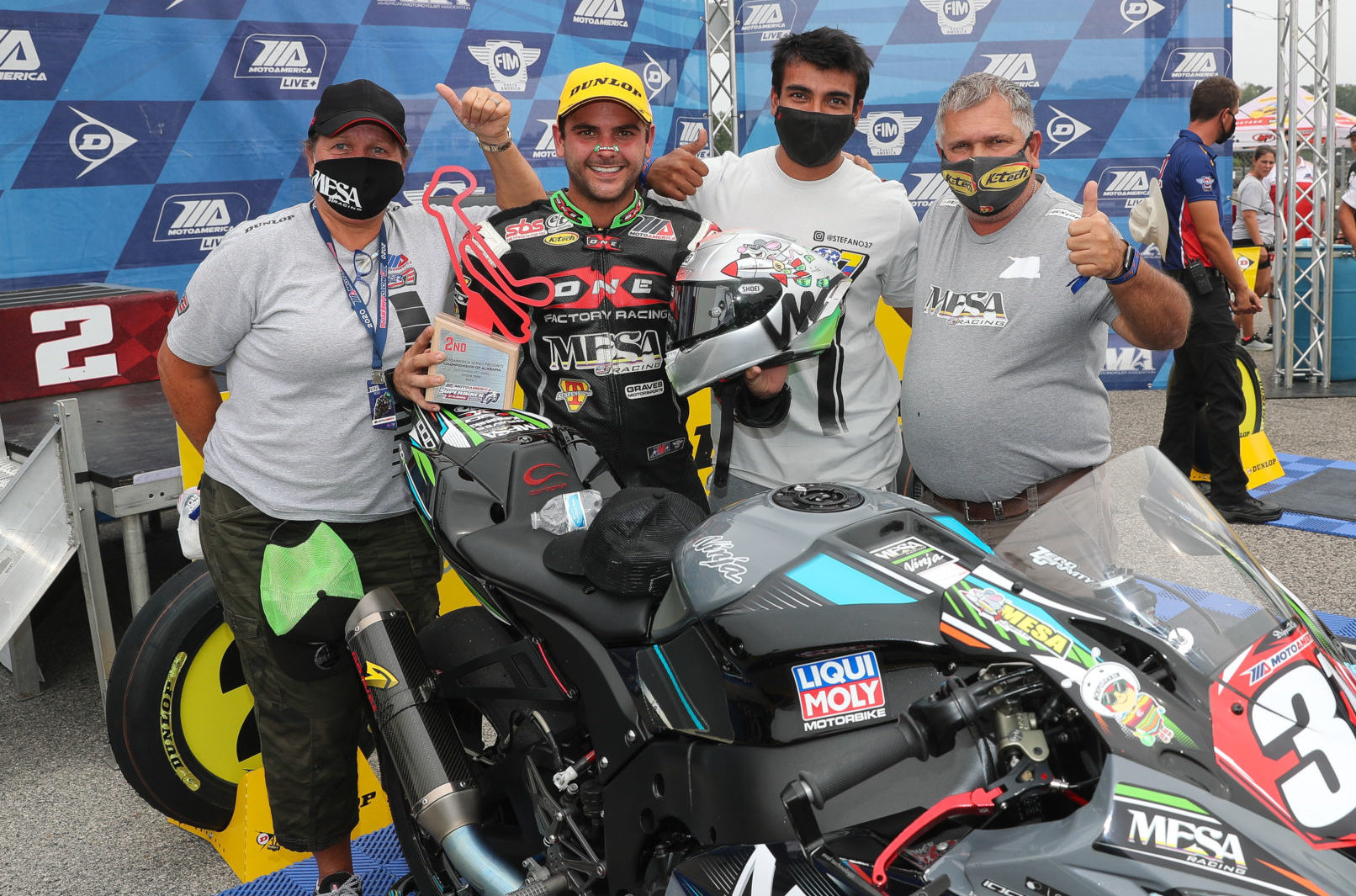 Stefano Mesa (second from left) with his father Mauricio (far right), his mother Karen (far left) and friend/crew member Erick Orozco (second from right) at the MotoAmerica Stock 1000 podium at Barber Motorsports Park. Photo by Brian J. Nelson.