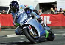 Mark Miller (1) on the MotoCzysz electric racebike at the Isle of Man TT in 2011. Photo courtesy of IOM TT Press Office.