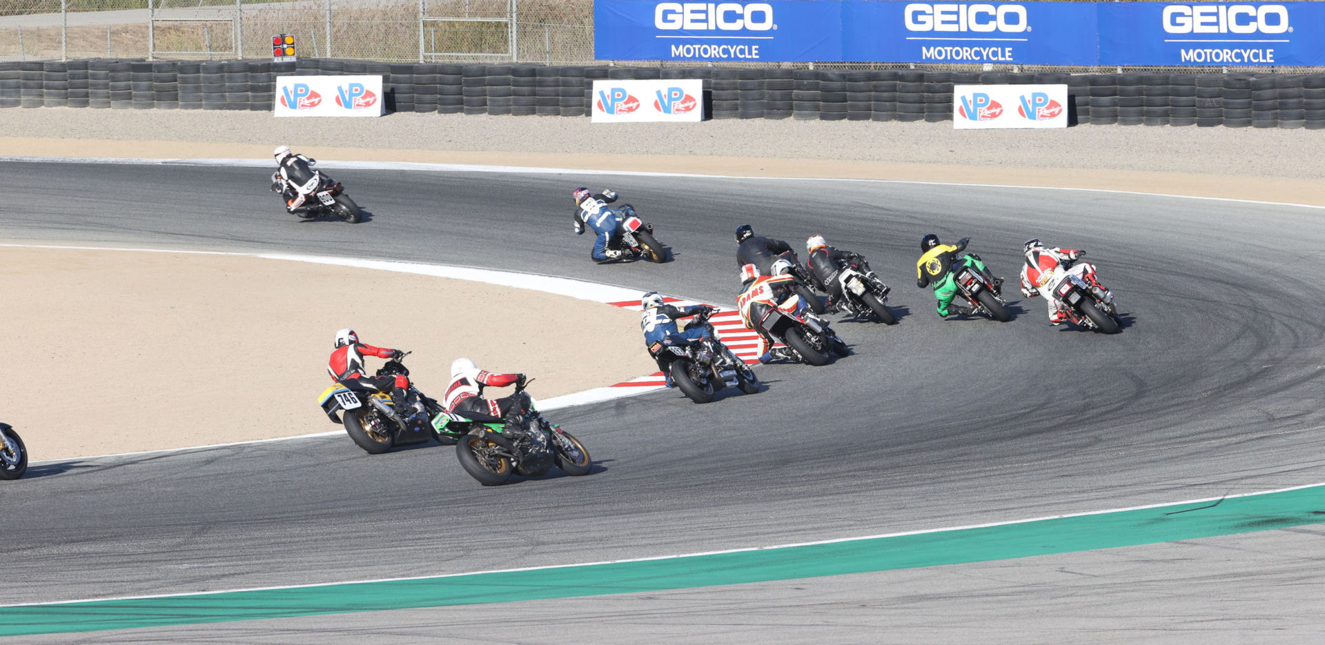 The MotoAmerica Heritage Cup/CSRA field carves through Turn Two at WeatherTech Raceway Laguna Seca. Photo by Brian J. Nelson, courtesy CSRA.