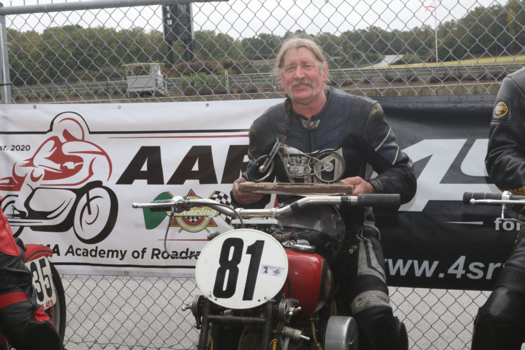 Ralph Wessell with his first-place trophy for winning the AHRMA Handshift Shootout. Photo by etechphoto.com, courtesy AHRMA.