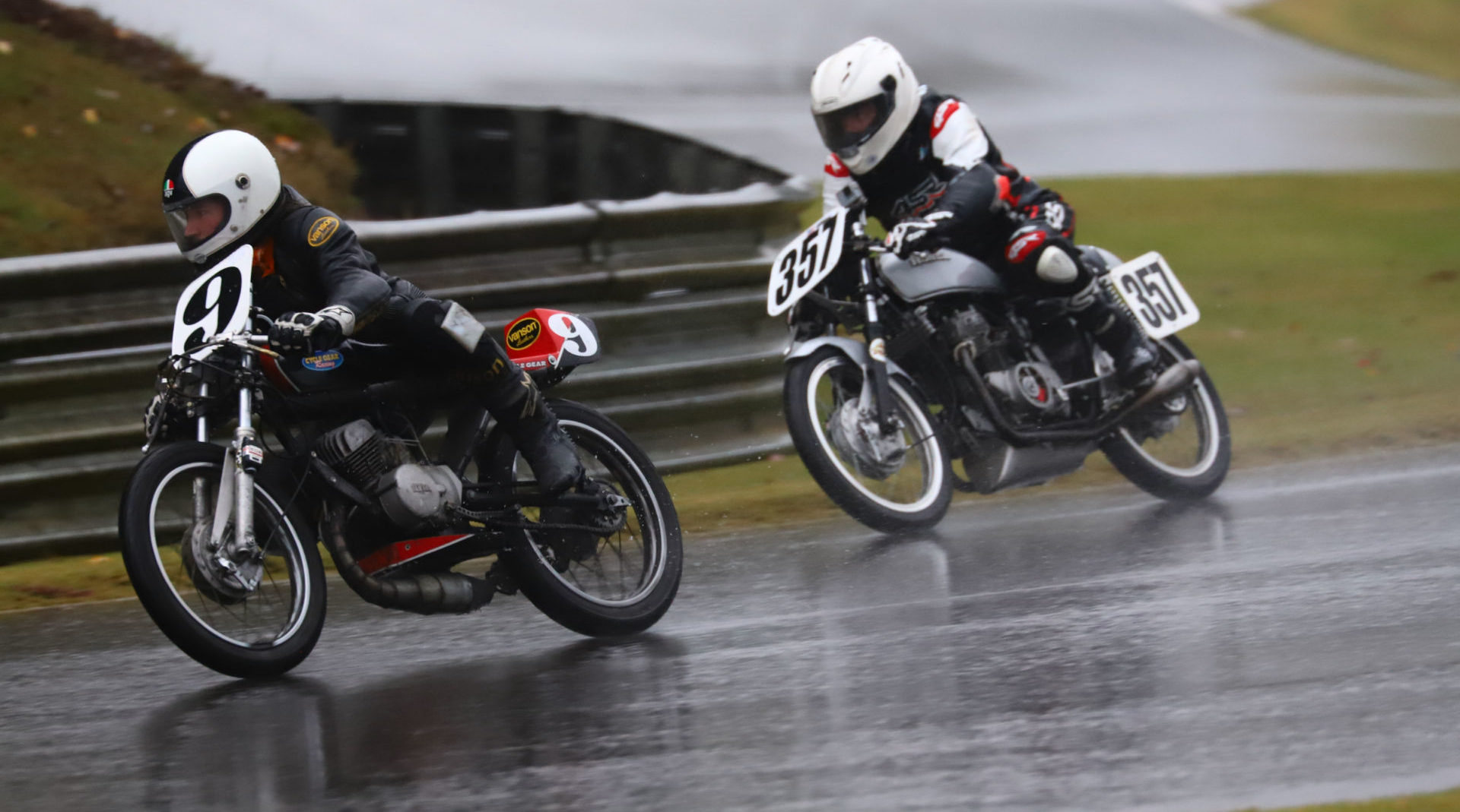 AHRMA racers Colton Roberts (9) and Joe Koury (357) at speed in the wet at Barber Motorsports Park. Photo by etechphoto.com, courtesy AHRMA.