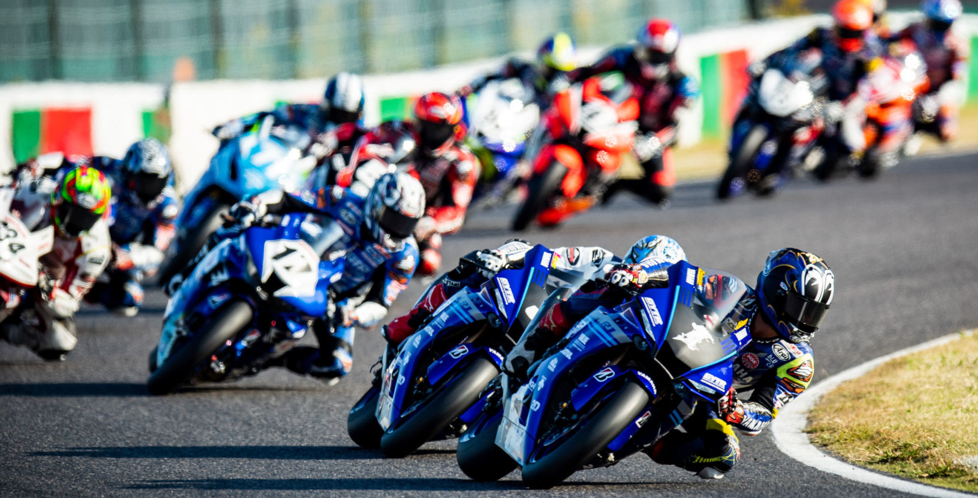 Katsuyuki Nakasuga (1) leads Kohta Nozane (3) and the rest of the field during the start of MFJ All-Japan JSB1000 Race One at Suzuka. Photo by Kohei Hirota Photography.