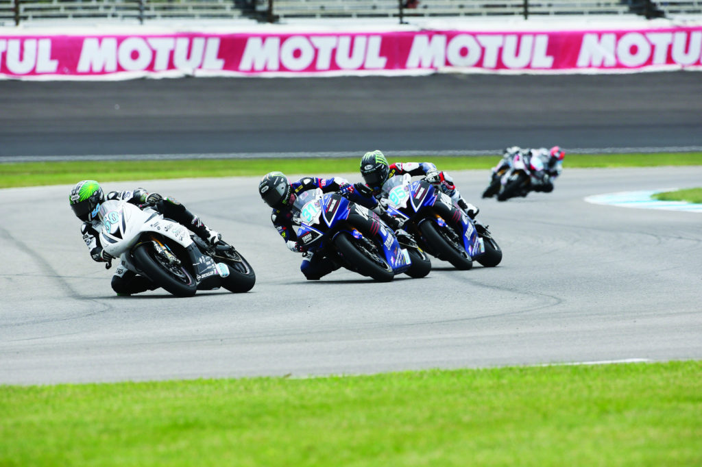 Bobby Fong (50) leads Garrett Gerloff (31) and JD Beach (95) into Turn Two during the lone MotoAmerica Supersport race at Indianapolis Motor Speedway in 2015. Photo by Brian J. Nelson.