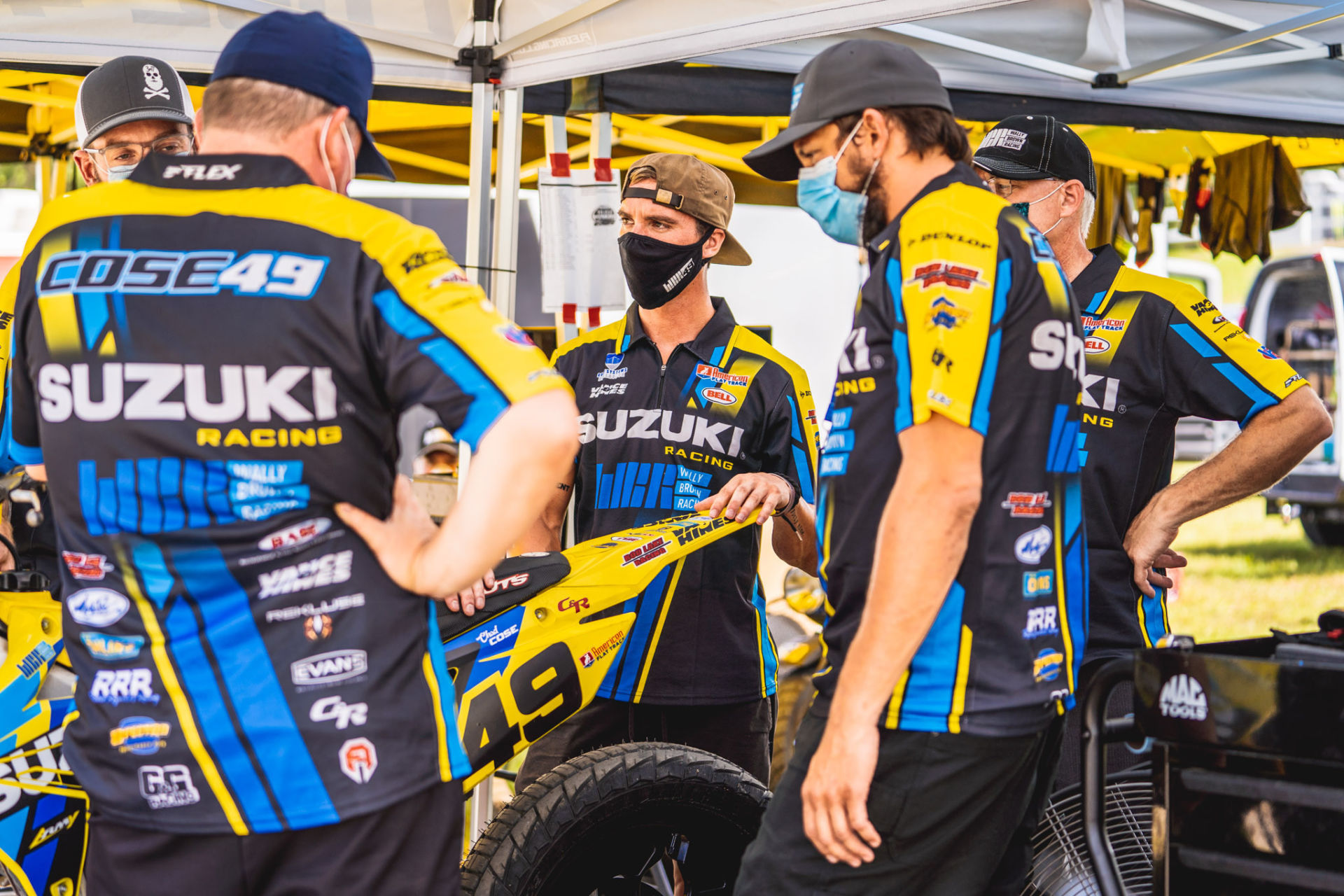 Chad Cose (center) surrounded by his Wally Brown Racing team. Photo courtesy Wally Brown Racing.
