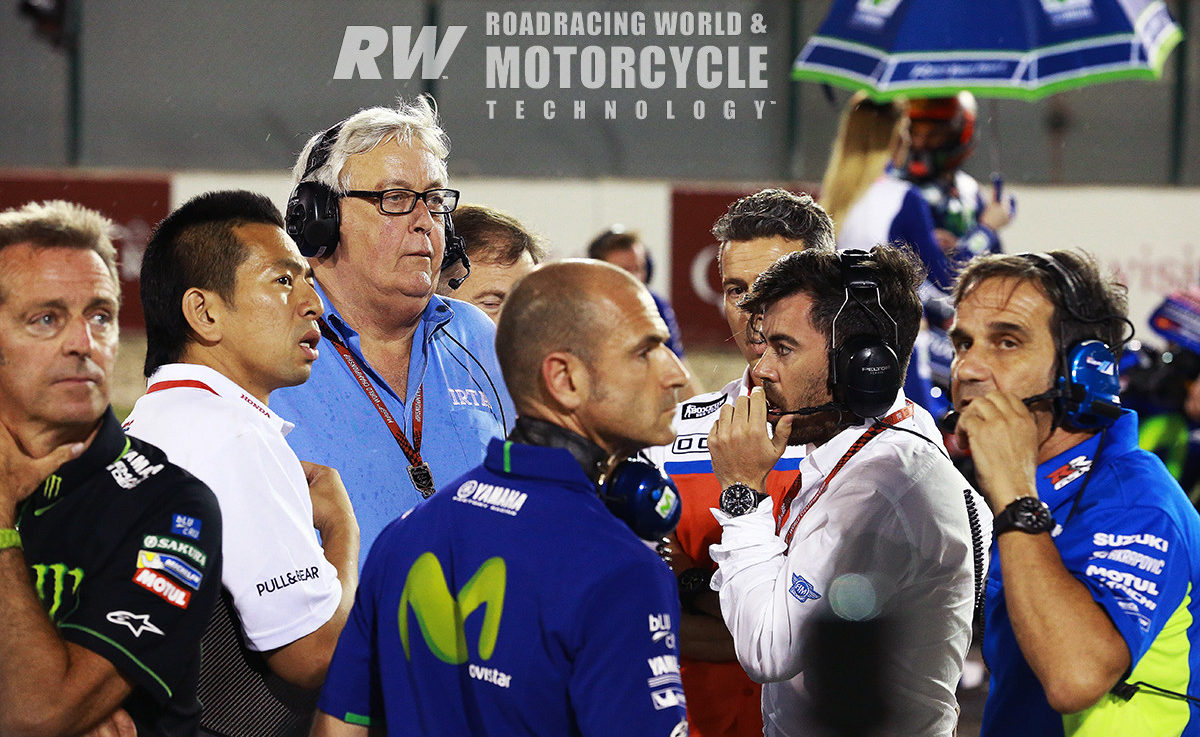 A towering presence among paddock luminaries, Mike Trimby (wearing glasses) on the MotoGP grid with (from left) Tech 3 owner Herve Poncharal, HRC Technical Director Takeo Yokoyama, factory Yamaha Team Manager Massimo Meregalli, Dorna's Carlos Ezpeleta, and Suzuki Team Manager Davide Brivio, Qatar, 2017. Mike Trimby had a lot to do with building MotoGP into the spectacle fans love. Photo by Gold & Goose.