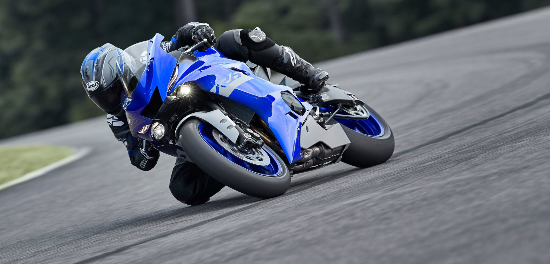 A 2020 Yamaha YZF-R6 streetbike at speed on a racetrack. Photo courtesy Yamaha Motor Corp., U.S.A.