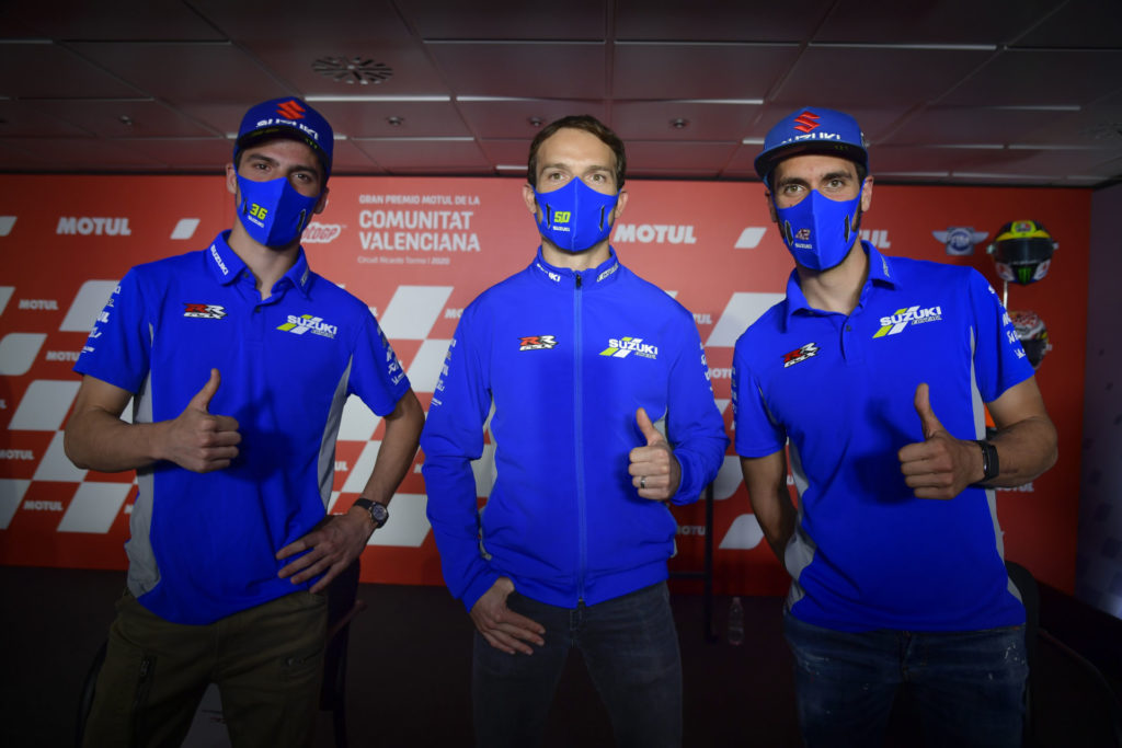 Team Suzuki ECSTAR racers Joan Mir (left) and Alex Rins (right) with test rider Sylvain Guintoli (center). Photo courtesy Dorna.