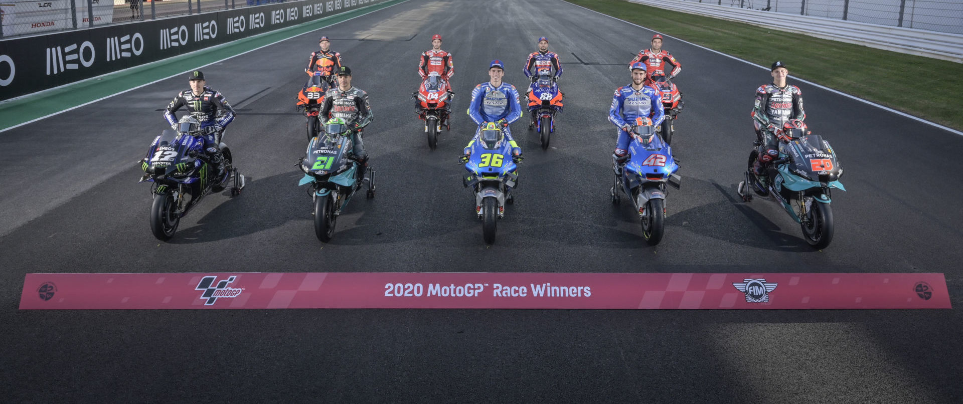 The nine different MotoGP race winners, so far, in 2020: Maverick Vinales (12), Brad Binder (33), Franco Morbidelli (21), Andrea Dovizioso (04), Joan Mir (36), Miguel Oliveira (88), Alex Rins (42), and Danilo Petrucci (9). Photo courtesy Dorna.