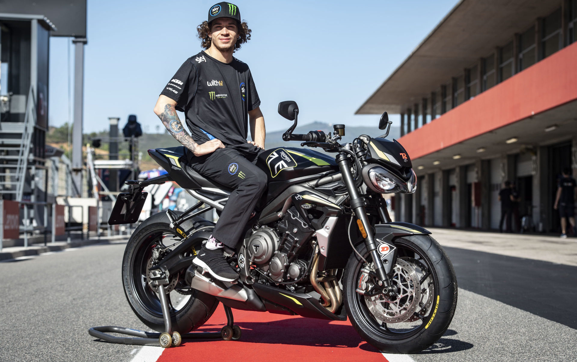 Marco Bezzecchi and the Triumph Street Triple RS that he earned for winning the Triumph Triple Trophy contest. Photo courtesy Triumph.