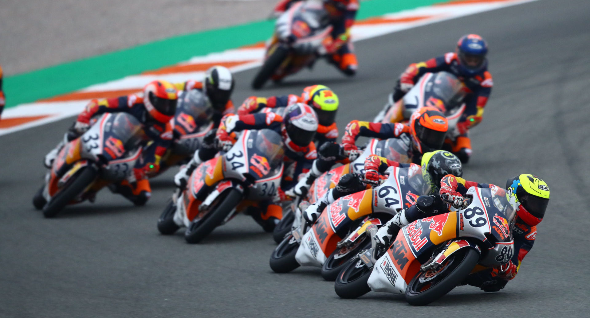 Marcos Uriarte (89) leads a pack of Red Bull MotoGP Rookies during Race One at Valencia II. Photo courtesy Red Bull.