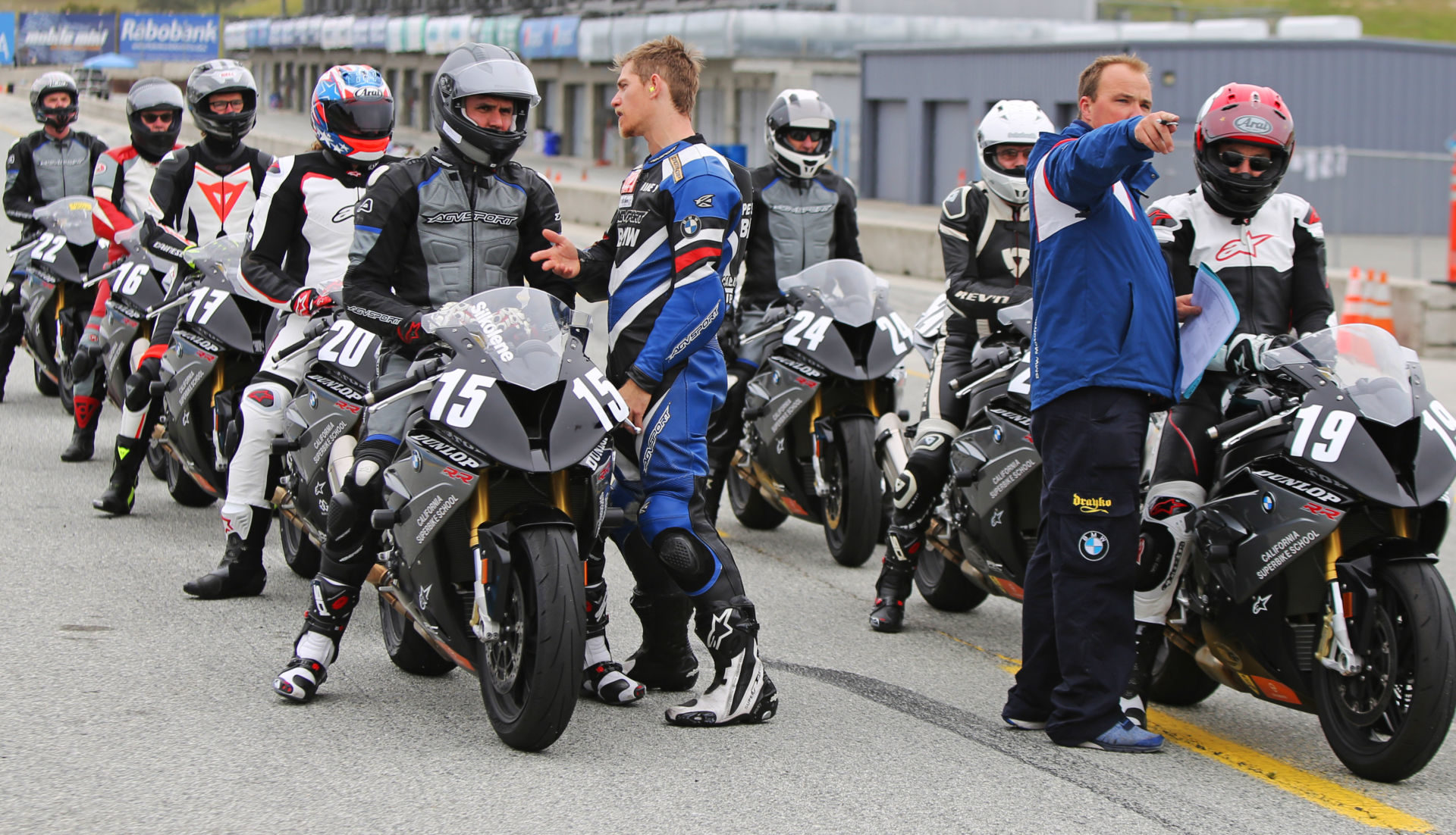 California Superbike School students lined up on pit lane at Laguna Seca. Photo by etechphoto.com, courtesy California Superbike School.
