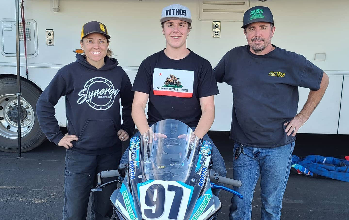Rocco Landers (center) with his father Stoney Landers (right) and MP13 Racing Team Owner Melissa Paris (left) at Chuckwalla Valley Raceway. Photo courtesy Rocco Landers.