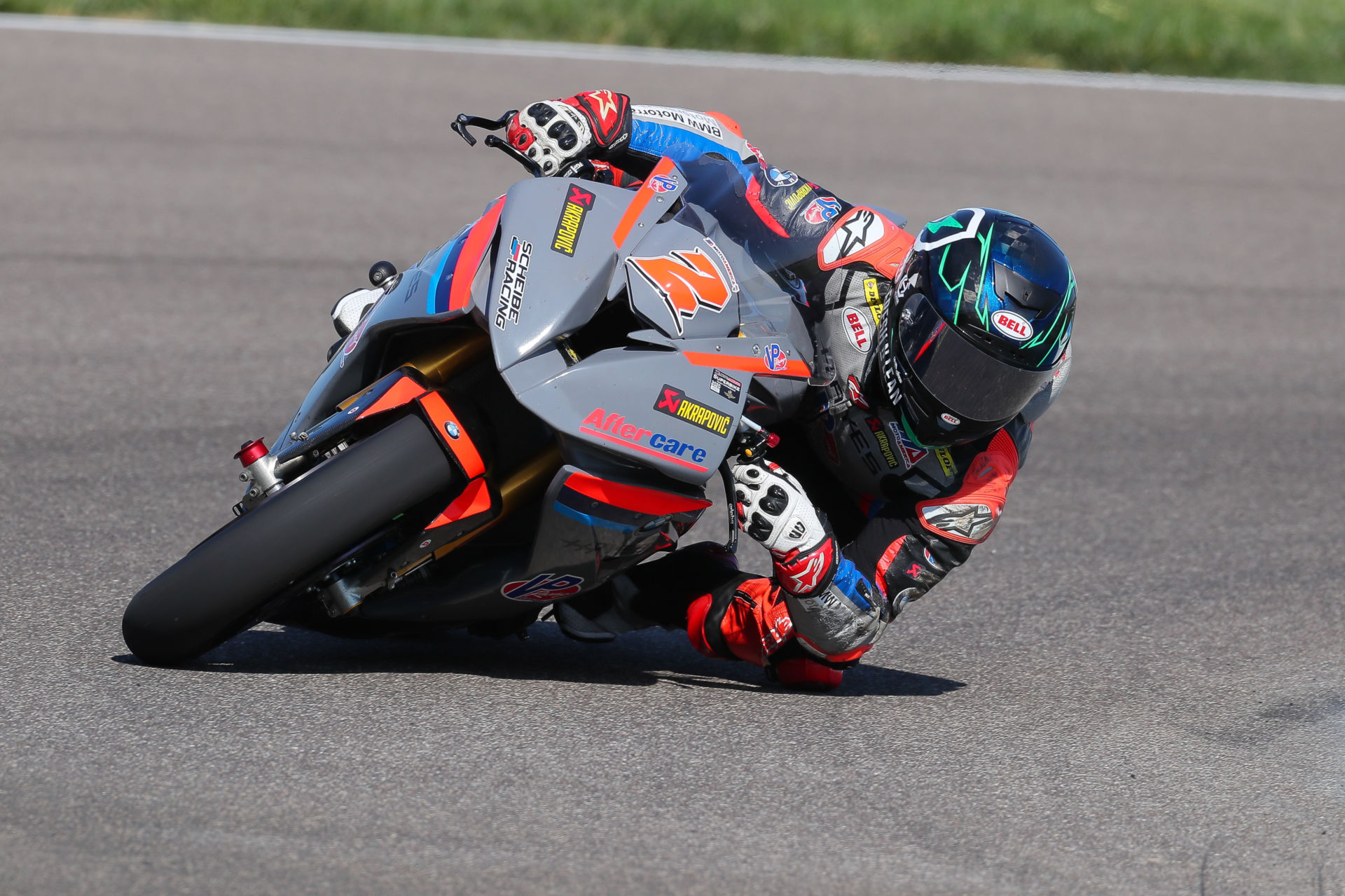 Josh Herrin (2) leaned over on his Scheibe Racing BMW S1000RR MotoAmerica Superbike at Indianapolis Motor Speedway. Photo by Brian J. Nelson.