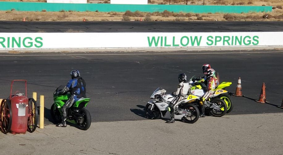 Tony Serra (left), age 81, prepares to go out on track at Willow Springs with a trio of younger riders (right). Photo courtesy WERA.
