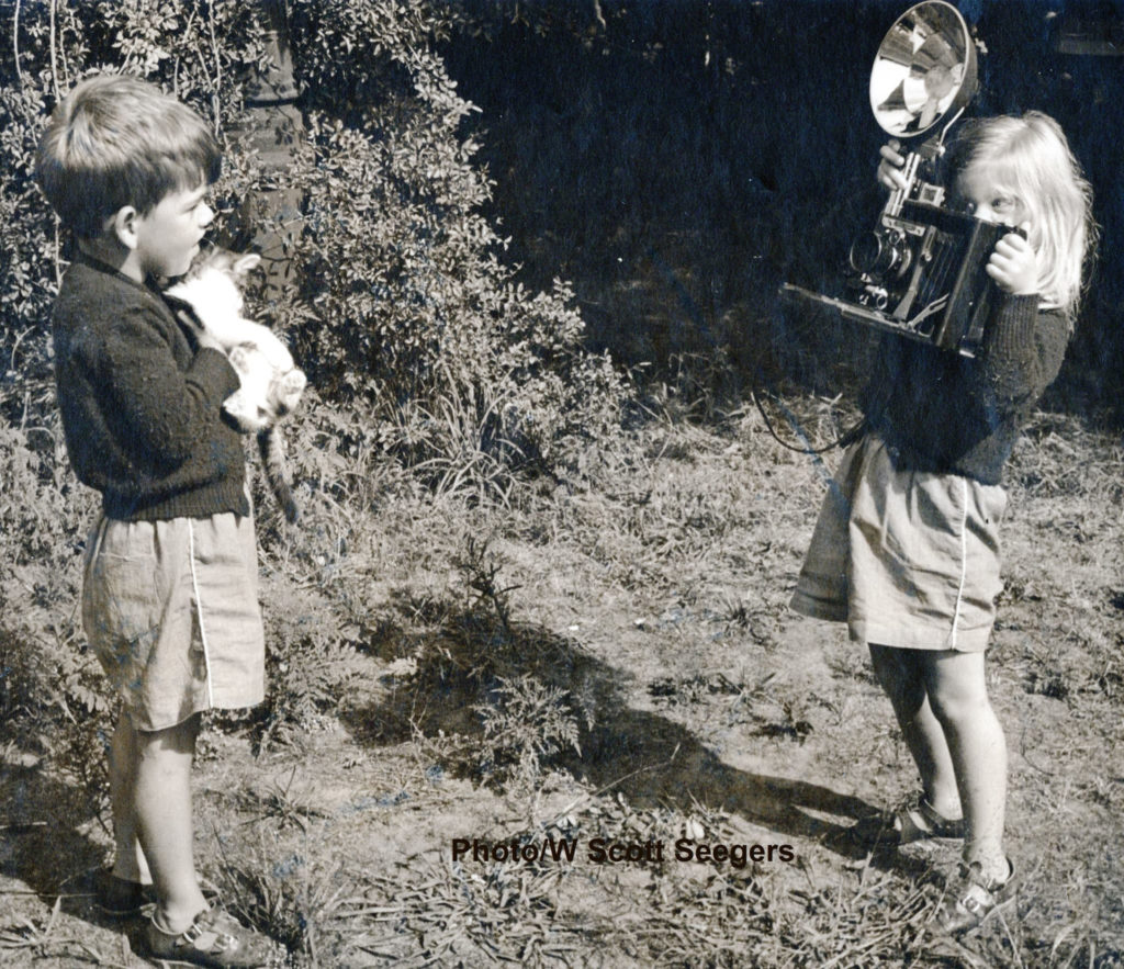 Mary (Seegers) Grothe (right) taking a photo of her brother Scotty Seegers (left) when they were children. Photo by William Scott Seegers, used with permission.