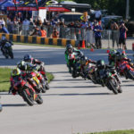 The start of a MotoAmerica Mini Cup by Motul race, featuring Ohvale spec motorcycles, at Road America in 2020. Photo by Brian J. Nelson.
